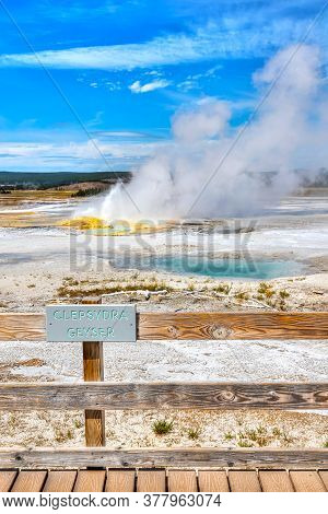 Clepsydra Geyser Erupts At Fountain Paint Pot Trail In The Lower Geyser Basin Of Yellowstone Nationa