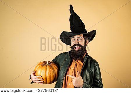 Handsome Halloween Man With Pumpkin In Hand. Happy Halloween - Handsome Man Isolated. Smiling Happy