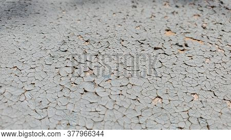 Peeling Texture Background With Copy Space. Discolored Surface With Deep Cracks And Distressed Wrink