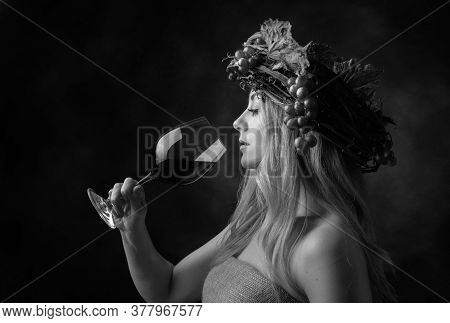 Portrait Of  Beautiful Caucasian Blonde Woman With Glass Of Red Wine. Shy Image Of A  Blonde Nymph I