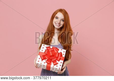 Smiling Redhead Girl In Plaid Dress Isolated On Pastel Pink Background. Valentines Day, Womens Day,