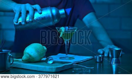 Barman Adding Alcoholic Drink Into The Cocktail Glass