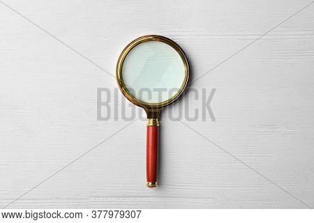 Magnifier Glass On White Wooden Background, Top View. Find Keywords Concept