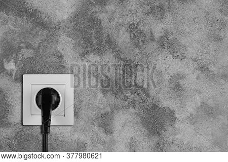 Stone Wall With Power Socket And Inserted Plug, Space For Text. Electrical Supply