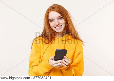 Pretty Young Redhead Woman Girl In Yellow Hoodie Posing Isolated On White Background Studio Portrait