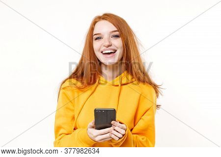 Laughing Young Redhead Woman Girl In Yellow Hoodie Posing Isolated On White Background Studio Portra