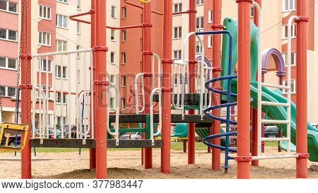 Children Playground Attractions Of Yellow And Red Colours In Dwelling Buildings Sandy Yard Close Vie