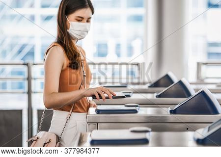 Closeup Hand Using Smart Mobile Phone Of Young Asian Woman Passenger Wearing Surgical Mask For Scann