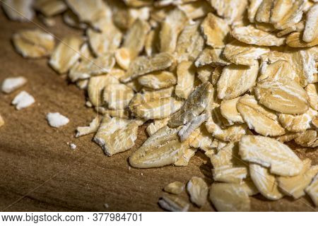 Dry Rolled Oat Flakes Oatmeal On Old Wooden Table Organic Oatmeal