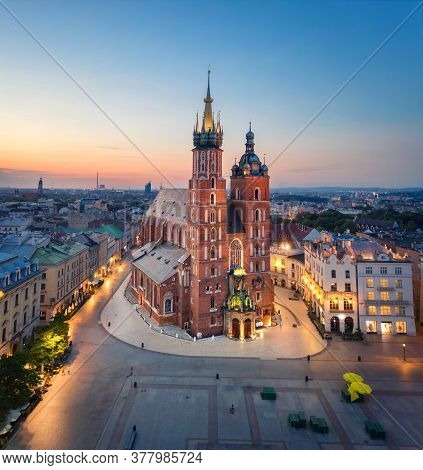 Krakow, Poland. Aerial View Of Illuminated St. Mary's Basilica (bazylika Mariacka) On Sunrise