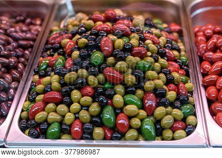 Fresh Organic Red, Green, Yellow And Black Olives Displayed For Sale At Naschmarkt A Street Food Mar