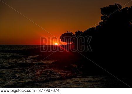 Beautiful Sunset On Adriatic Sea In Croatia, Waves On Rocks On Shore Of Dugi Otok Island. Amazing Se