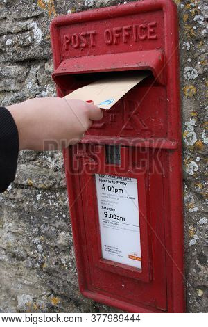 Someone Posting A Letter In A Royal Mail Post Box In The Wall,  Taken 28th Of October 2008 In Witney