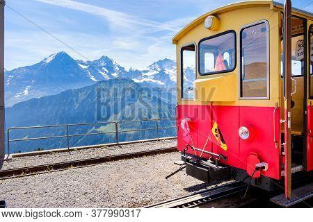 Schynige Platte, Bernese Oberland, Switzerland - August 1 2019 : Tourist Train On A Bright Summer Da
