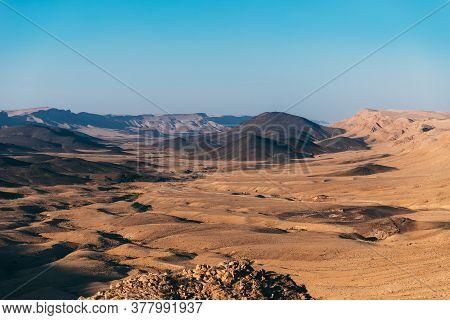 Makhtesh Ramon Crater Landscape In Israel's Negev Desert. Near To Mizpe Ramon City On South Israel.