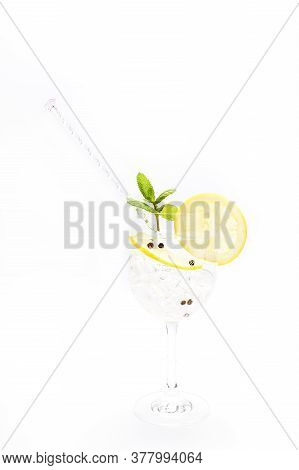 Gin And Tonic In A Cup With Lemon, Mint And Black Pepper. Concept Celebration, Party. White Backgrou
