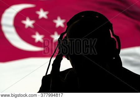The Silhouette Of A Man With Headphones, Listening Secret Agent, Spy And Intelligence Officer, The S