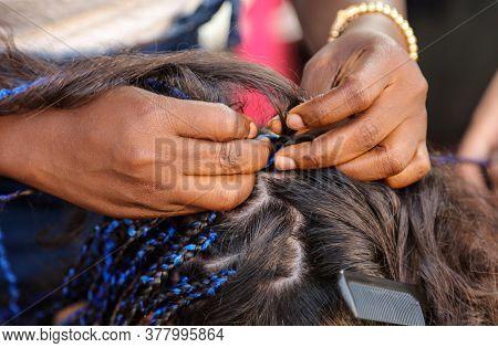 Girl Braids Blue African Braids In A Beauty Salon.