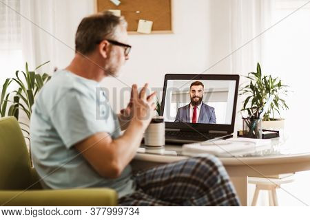 Businessman Chatting With His Colleague. Working At Home.back View Of Business Man Talking To His Co