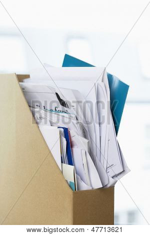 Closeup of box file crammed with papers