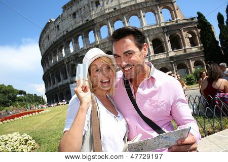 Tourists holding visitor's museum pass in Rome