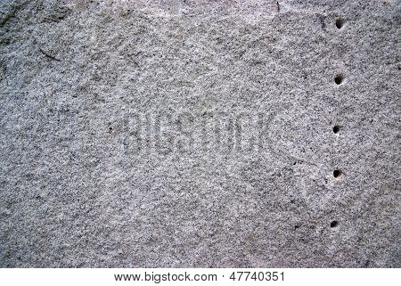 Round hole on the granite.The surface of Black and white granite stone. For texture background poster