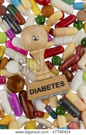 stamp on colorful tablets, symbolic photo for diabetes, prescription drugs and