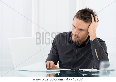 Stressed Man Working On Laptop