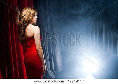 Beautiful woman posing in front of the scenes