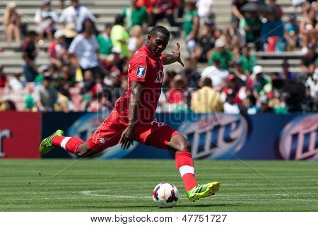 PASADENA, CA - JULY 7: Doneil Henry #20 of Canada during the 2013 CONCACAF Gold Cup game between Canada and Martinique on July 7, 2013 at the Rose Bowl in Pasadena, Ca.