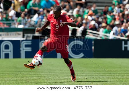 PASADENA, CA - JULY 7: Tosaint Ricketts #9 of Canada in action during the 2013 CONCACAF Gold Cup game between Canada and Martinique on July 7, 2013 at the Rose Bowl in Pasadena, Ca.