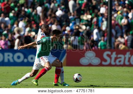 PASADENA, CA - JULY 7: Efrain Velarde #15 of Mexico and Gabriel Gomez #6 of Panama during the 2013 CONCACAF Gold Cup game between Mexico and Panama on July 7, 2013 at the Rose Bowl in Pasadena, Ca.