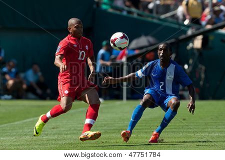PASADENA, CA - JULY 7: Simeon Jackson #10 of Canada & Nicolas Zaire #2 of Martinique during the 2013 CONCACAF Gold Cup game between Canada & Martinique on July 7, 2013 at the Rose Bowl in Pasadena, Ca