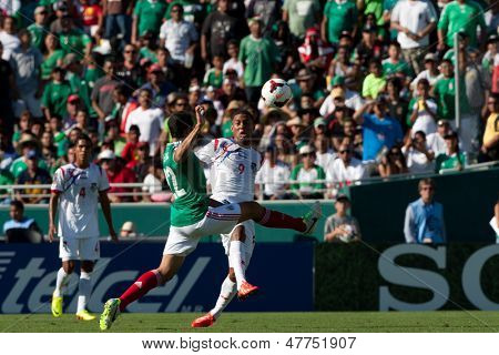 PASADENA, CA - JULY 7: Alejandro Castro #22 of Mexico and Gabriel Torres #9 of Panama in action during the 2013 CONCACAF Gold Cup game between Mexico and Panama on July 7, 2013 at the Rose Bowl.