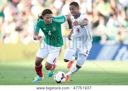 PASADENA, CA - JULY 7: Carlos Pena #6 of Mexico and Gabriel Torres #9 of Panama during the 2013 CONCACAF Gold Cup game between Mexico and Panama on July 7, 2013 at the Rose Bowl in Pasadena, Ca.
