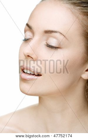Portrait Of Beautiful Young Woman With Drops Of Water