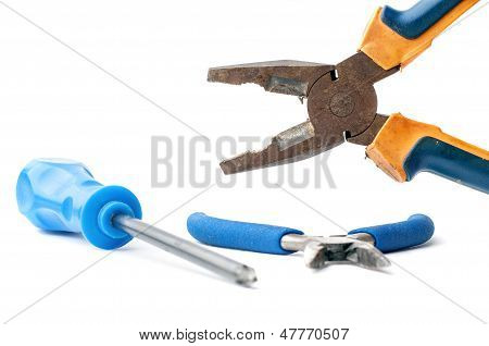 Rusty pliers and screwdriver on white