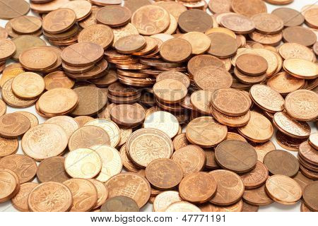 A lot of euro coins on a table