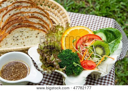 Fusion Food, fresh salad and sesame bread. poster