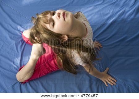 Young Woman Doing Yoga Moves Or Meditating.