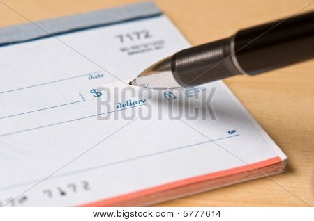 Pen writing a check