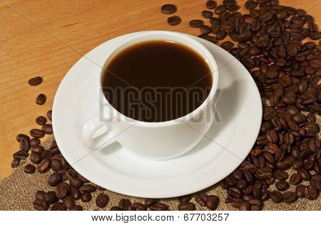A Cup Of Coffee With A Lot Of Coffee Beans