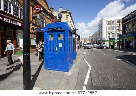 LONDON - JUNE 11, 2014: Public call police box with mounted a modern surveillance camera near Earl's Court tube station in London.