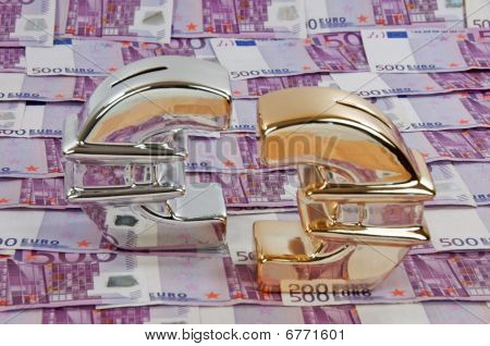 500 Euro Bills And Gold And Silver Symbol