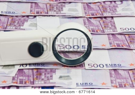 500 Euro Bills And Magnifying Glass Vista