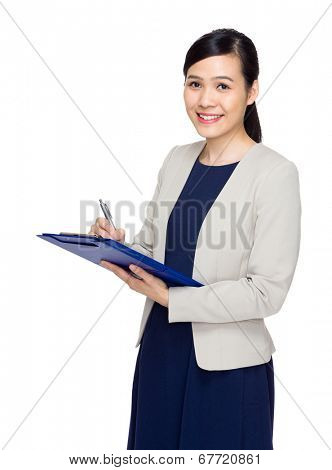 Asian business woman jot down information on file pad