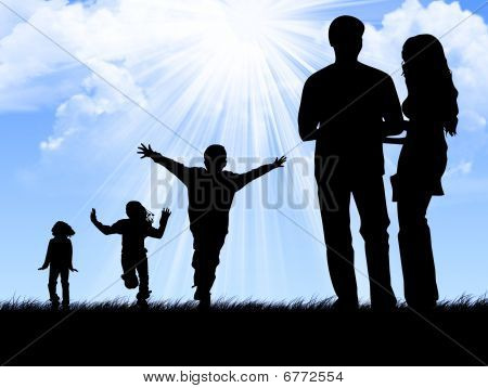 Young family silhouettes
