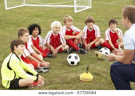 Junior football team training with coach poster