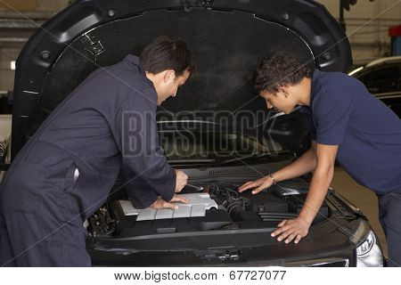 Trainee mechanic at work