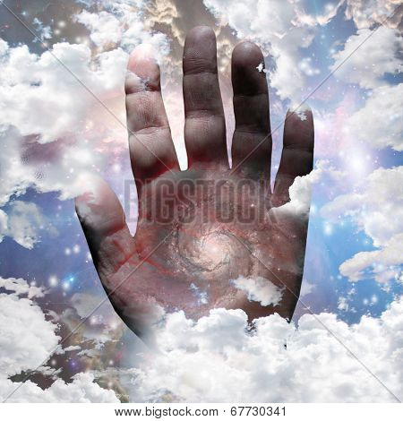 Galaxy on hand in bright nebulous clouds Elements of this image furnished by NASA